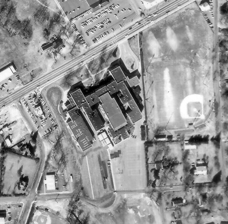 Black and white aerial photograph of the old Fairfax High School taken in 1968. The building has been added onto significantly since it first opened.